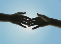 Hands Touching Against the Sky